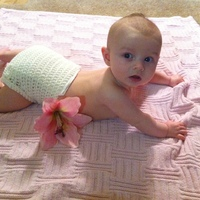 Lily in crocheted diaper cover.jpg