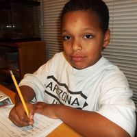 Ty age 7 doing homework