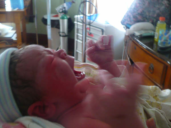 Ocean Zey born after 7 1/2 hours of labor. He was my fourth baby. He was also born after 42 weeks! :)