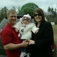 Thomas, savannah, and I after cutting down our first christmas tree at the christmas tree farm