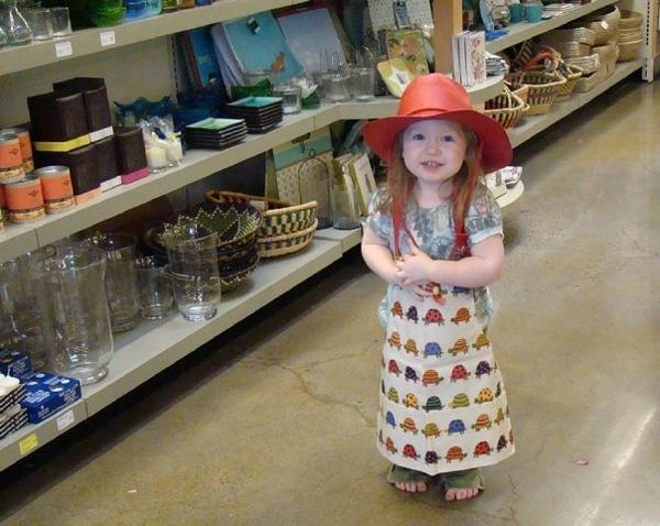Allie playing dress up at the store