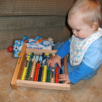 Playing with his abacus.