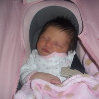 sleepin in her carseat.