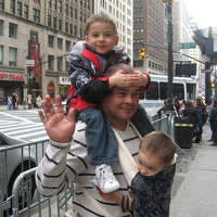 We were visiting NYC for the day and my husband was wearing our 2 year old in his mei tei.  When my 4 year old grew tired of walking he hitched a ride on daddys shoulders.  Who needs a taxi when you have dad?
