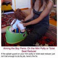 044-Aiming-the-Boy-Penis-On-the-Mini-Potty-or-Toilet-Seat-Reducer.jpg