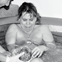 My midwife, Genevieve during the home waterbirth of my daughter. The photo says it all. :)