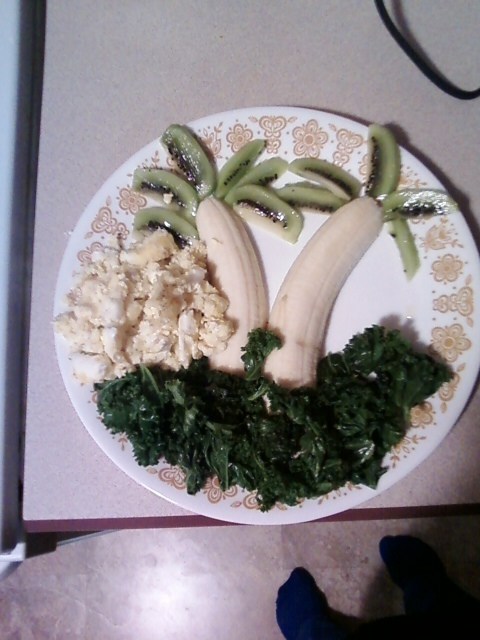 This was breakfast this morning... Only 5 points!!! 1 banana, 1 kiwi, braised kale, 2 eggs scrambled. Yum!