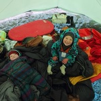 kids in tent on glacier