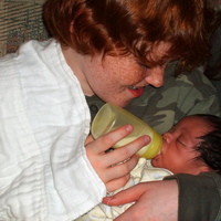Seamus giving Keegan his first bottle, on the day he joined our family Feb 14th, 2008 at three weeks old.