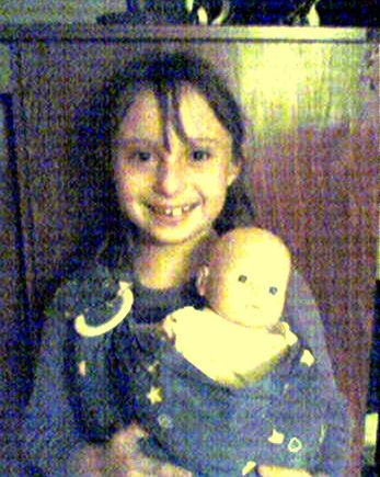 My oldest wearing her dolly, c. 2003