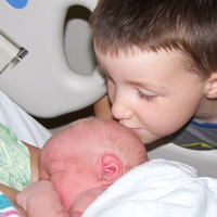 My boys at the hospital after DS2's birth (he's nursing, see?).