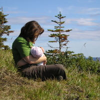 Breastfeeding on top of the first mountain I hiked to the top of.