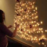 Light string on wall Xmas tree. 