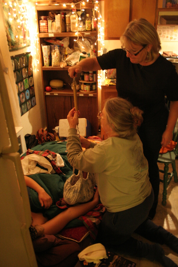 My midwife Shelagh and Kathy, her assistant. They're weighing baby Kailen the old fashioned way! Shelagh is the only home-birth midwife in Del Norte County, California.