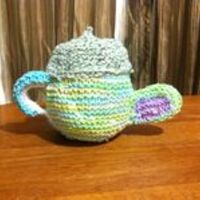 Knitted Tea Kettle from member Encinalien --  Basic Instructions Here: http://www.mothering.com/community/t/1369582/the-annual-mothering-handmade-gifts-ideas-photo-contest#post_17192886