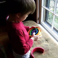 My eldest son, at 5, playing with the rainbow stacker