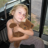 my oldest (7) and his favorite bear on our bus