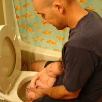 Daddy helps Finn use the potty- newborn