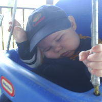 He fell asleep while mommy was pushing him in his porch swing!