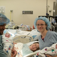 The first set of twins that I doula-ed. A lovely natural birth, held in the OR due to hospital policy.