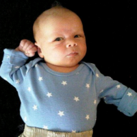 Benny at 2 Weeks in Star Shirt.png