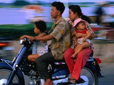 banagan-john-young-family-on-motorcycle-phnom-penh-cambodia.jpg