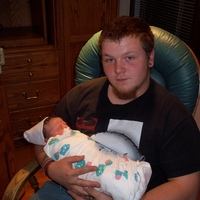 daddy holding adrianna for the first time =] <3