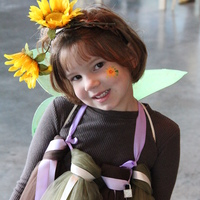 A Woodland Fairy Costume. We had made her original costume in July, but we moved and it went MIA...which we didn't realize until the morning of; so we threw this together and she LOVED it!
