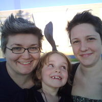 I'm the one on the right. The thing on our daughter's head is a dorsal fin from her play. ;)