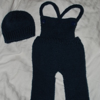 knitting up a storm.   overalls and hat were my second big project.