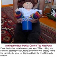045-Aiming-the-Boy-Penis-On-the-Top-Hat-Potty.jpg