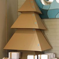 A DIY cardboard Xmas tree: http://www.feeldesain.com/diy-cardboard-christmas-tree.html